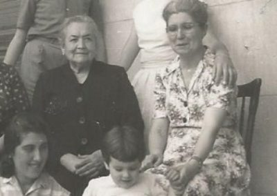 1958: With Grandma Carme, mother and sisters